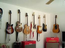 how to hang a guitar on the wall guitar hanger wall valuable how to hang guitar how to hang a guitar on the wall