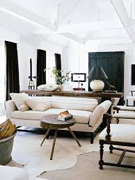 darryl carter living room with layered cowhide rug on thou swell thouswellblog