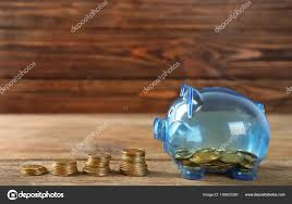 piggy bank and coins on wooden table pension planning stock photo