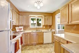 kitchens with wood cabinets and white appliances. Delighful Appliances Traditional Kitchens With White Appliances Light Wood Kitchen Cabinets  Lighting In And S
