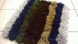 completed yarn pom pom rug