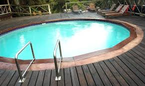 above ground pool decks this above ground swimming pool has wooden decking that surrounds the entire