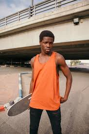 Casual street style in an orange tank from the new menswear.