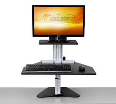 adjule height desk kangaroo black in the standing position with a monitor