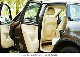 modern car with open door outdoors