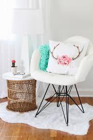 a comfy chair faux fur rug cute pillows and a lamp all