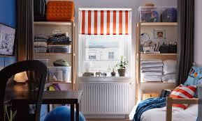 dorm room furniture ideas. The Back Wall Of A Dorm Room With Shelving Filled Bedding, Make Up, Furniture Ideas T