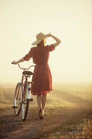 Image Moving Woman In Hat With Bike Woman In Hat With Bike In The Countryside At Sunrise Sprout Social Justified Image Grid Premium Wordpress Gallery