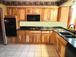 kitchen with hickory cabinets and black appliances