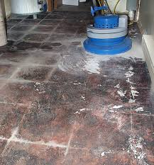 glue and removal from concrete floor after the tiles on carpet