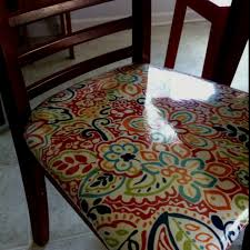 chairs recovered in fabric and clear vinyl using this idea to recover some retro kitchen chairs found in a garage