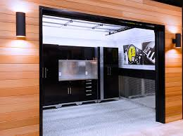 garage living s showroom features numerous garage room settings and operational garage doors here our customers can visualize flooring cabinetry