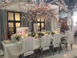 ralph lauren home s table set for ten was gorgeously styled under a crystal chandelier accented with branches and blossoms