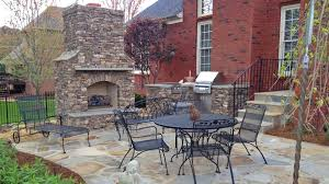 a backyard can be many things a lawn a dog run or a playground just to name a few one homeowner in mt juliet tn wanted a fireplace and kitchen a