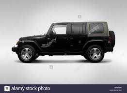 2009 jeep wrangler unlimited sahara in black drivers side profile stock image
