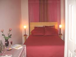 bedroom design for couples. Bedroom, Desklamps On Bed Sidetable Pink Bedlinen Pillows Headboard Sideboard White Wall Paint Windows Curtain Bedroom Design For Couples