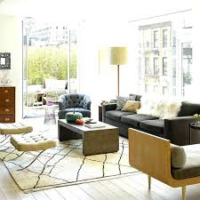 white fur area rug living room low white table console black leather slat back couch fur white fur area rug white faux
