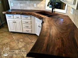 diy wooden kitchen countertops. this pure walnut slab counter-top adds depth to kitchen with its dark-warm browns. diy wooden countertops