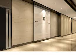Office interior doors Sliding Commercial Office Typical Lobby Interior Design Stone And Bronze Pinterest Commercial Office Typical Lobby Interior Design Stone And Bronze