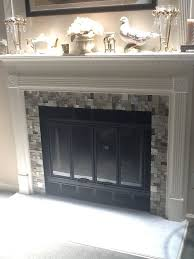 glass tile fireplace done over existing marble surround used mirror adhesive so easy
