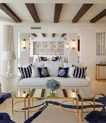 coastal inspired living room with coffee table in gold and mirrored top design seed