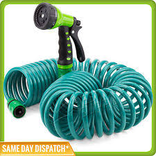 garden hoses. Expandable Flexible Coiled Garden Hose With A 7 Pattern Spray Gun - 12m / 40ft Hoses
