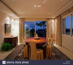 Modern Patio Doors Down Lighting In Modern Spanish Dining Room At Night With Patio