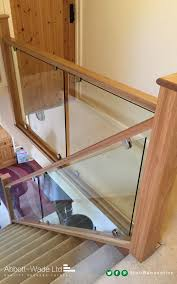wooden handrail with a glass barade