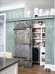 As we've seen before, sliding barn doors in the kitchen are great for  entertaining and flow, but as these photos show they work just as well as a  pantry ...