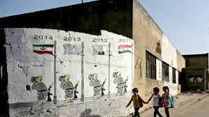isis main office. A Mural In The Town Of Kafranbel Depicts Stages Syrian Conflict. Khalil Ashawi / Reuters Isis Main Office
