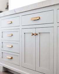 copper knobs and pulls. grey cabinets + copper hardware knobs and pulls
