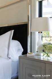 A contemporary, chrome bed frame is tempered by the transitional, wood  nightstand. in