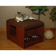 ikea hacker has numerous house made ones that have been hacked out of regular ikea benches and cabinets the kitty entrance doorway can be created on the catbox litter box enclosure
