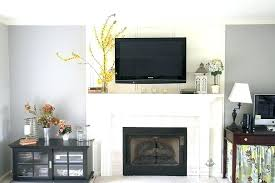hide cables mounting above fireplace hiding wires television over the and how to hdmi wall mounted