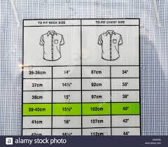 Size Chart On The Back Of Retail Packaged Shirt Stock Photo