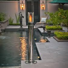 outdoor lighting design with chrome lit high pillar torch fire by brasa fire