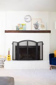 painted white brick fireplaceHow to Paint a Brick Fireplace White  Lovely Indeed