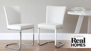 white cantilever dining chairs