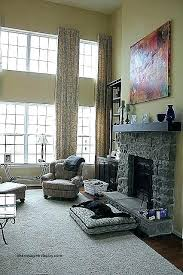 two story family room curtains lovely window new 2 with fireplace ceiling and entertainment wall chandelier