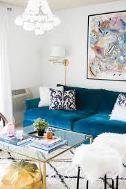 blue velvet couch in glam living room