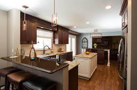 kitchen with dark stained cabinets white center work island and separate snack bar