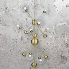 cl 35104 is a modern 10 light polished brass sputnik chandelier