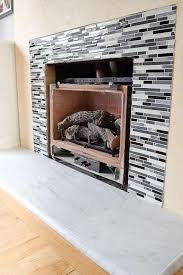 my fireplace remodel is almost at the finish line the fireplace tile is up