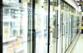 a row of glass fridge doors at a local chandler az supermarket the doors were