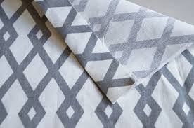 set your iron to wver temperature the instructions on your hem tape instructs lift your folded hem and put a piece of hem tape cut to size at the