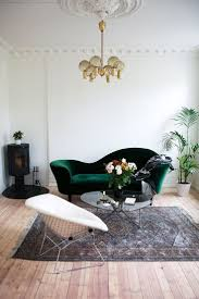 my scandinavian home: The relaxed Norwegian home of Maja Hattvang. that Emerald  green velvet sofa, so glam!