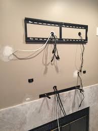 tv mounting over a fireplace with wires concealed in the wall for tv cables decor 5