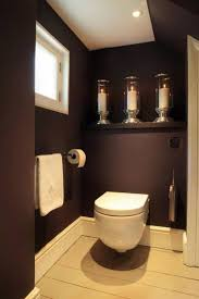 Bathroom , Modern Wall Hung Toilet : Wall Hung Toilet With Dark Brown Walls  And Towel