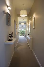 Hallway Lighting Hallway Illuminated With Drum Shade Pendants And Wall Sconces
