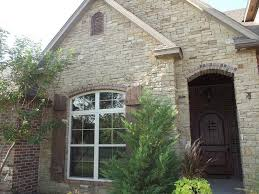 Dry Stack Stone exterior, shutters and door
